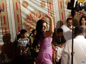 Shazia dances for the cameras at a party.