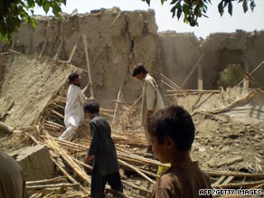 Villagers gather at the rubble of houses belonging to supporters of Pakistani Taliban chief Baitullah Mehsud..
