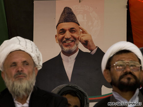 Supporters of Afghan President Hamid Karzai join in an election rally Wednesday in Kabul.