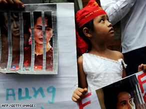 A girl holds a portrait of Aung San Suu Kyi at a rally in Bangkok, Thailand, on Tuesday.