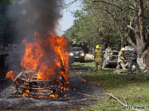 A car burns after the suicide blast outside NATO's Afghanistan headquarters during the weekend.