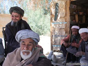 Cobbler Kaka Muchi [right] and friends say they will vote for Karzai, because Bamiyan province has enjoyed security in recent years.