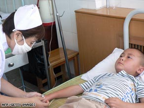A Chinese boy gets treated for blood poisoning in Shaanxi province Aug. 15.