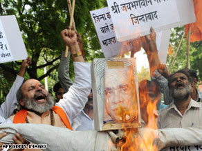 Protesters burn effigy of author Jaswant Singh over his book; Singh, a former foreign minister, was ousted from his party for his views.