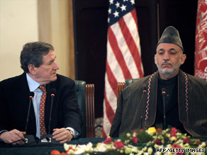 Afghanistan President Hamid Karzai, right, and Richard Holbrooke at a meeting in Kabul on February 15.