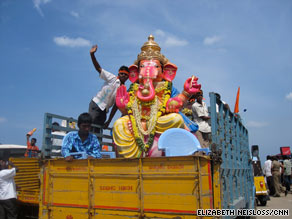 Ganesha worshippers transport their Idol for an immersion ritual.