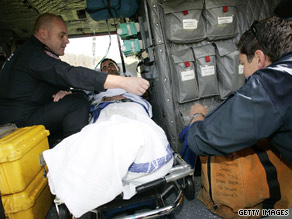 Water Minister Tim Holding prepares to be transported via air ambulance to Melbourne Tuesday in Mount Hotham.