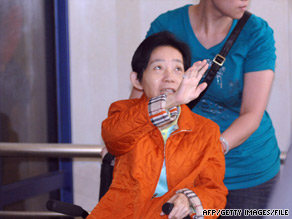 Wheelchair-bound Taiwan former first lady Wu Shu-chen leaves a hospital in Panchiao, Taiwan, in May.