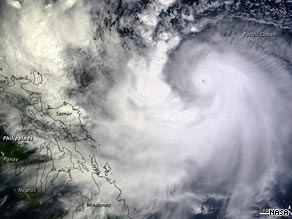 A NASA satellite image shows Typhoon Parma as it headed toward the Philippines on Friday.