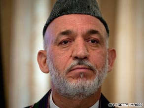 Afghan President Hamid Karzai, here in the photo, has long been considered by his brother Ahmed Wali Karzai to be an American puppet.