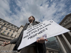 A protester addresses city workers outside the Bank of England in London on Tuesday.