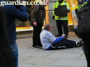 A video posted by the Guardian shows police shoving Ian Tomlinson to the ground. He later died of a heart attack.