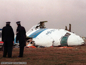 Police officers survey the wreckage of Pan Am Flight 103 in December 1988.