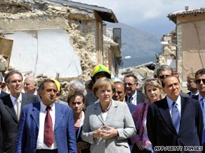 German Chancellor Angela Merkel, center, and Italian PM Silvio Berlusconi, right, visit the quake zone.