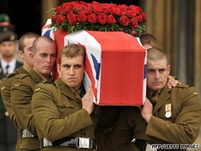 The coffin draped in a Union Jack flag is taken away from Well Cathedral.