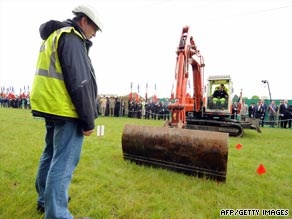 File photo shows a crane unearthing the mass grave in northern France.
