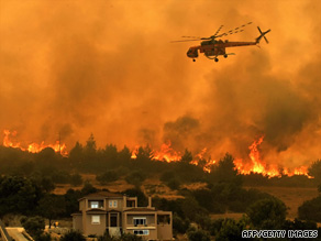 Aircraft were mobilized Saturday to help firefighters battle a blaze northeast of Athens, Greece.