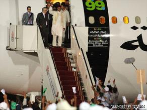 Abdelbaset Ali Mohmed al Megrahi (second from left) arrives in Tripoli, Libya on August 21.