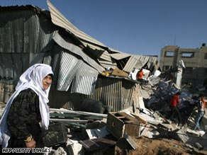 Palestinians in Rafah look over the remains Wednesday of buildings destroyed by Israeli bombardment.