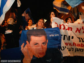 A portrait of Gilad Shalit is held during a protest demanding his release in Tel Aviv, Israel, in January.
