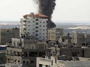 Smoke rises over the Gaza border town of Rafah after an Israeli air attack Wednesday.