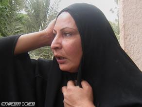 An Iraqi woman waits for news outside the Kadhimiya Hospital after the Baghdad bombings Friday.