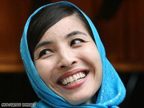 Roxana Saberi smiles outside her home in Tehran, Iran, on Tuesday.