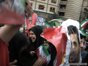 Supporters of President Ahmadinejad wave flags at a massive rally in Tehran Sunday to celebrate his victory.