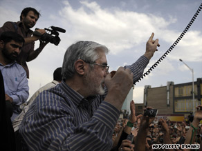 Mir Hossein Moussavi addresses supporters Monday in Tehran, Iran. He's called for a massive march Thursday.