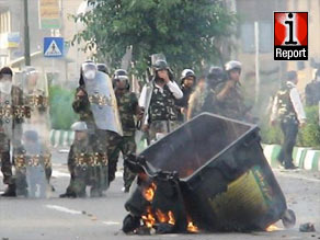 Members of the Basij paramilitary block a road leading to Freedom Square in Tehran.