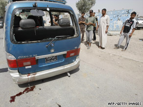 A roadside bomb hits a minibus Monday in Baghdad's Sadr City, leaving a bloody scene with three dead.