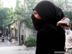 A woman is seen throwing a rock at one recent protest in Tehran.