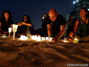Iranians in Dubai hold a candlelight vigil Thursday for Neda Agha-Soltan, who was slain in election protests.