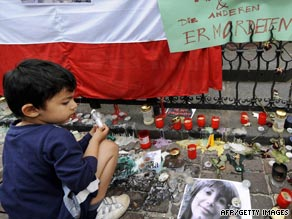 A boy lights a candle beside a photo of Neda during a protest against Iranian elections in Frankfurt, Germany.