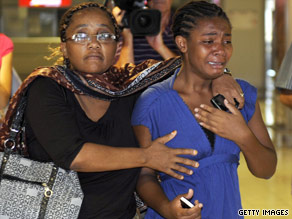 Relatives of passengers of the plane that crashed await news at Marseille airport in southern France.