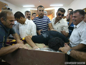Family members of Rizko Aziz Nissan grieve before his funeral in Kirkuk, Iraq, on Sunday.