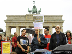 A small group of protesters at Berlin's Brandenburg Gate on Friday.