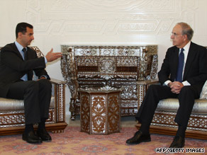 U.S. special envoy George Mitchell, right, and Syrian President Bashar al-Assad meet in Damascus on Sunday.