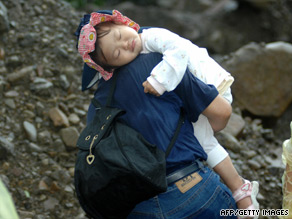 A girl is carried out from mudslide caused by Typhoon Morakot in southern Taiwan on Monday.
