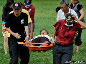Rescuers carry an elderly survivor of flooding Tuesday in southern Taiwan after Typhoon Morakot struck.