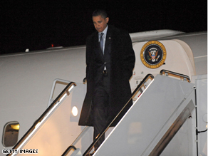 President Elect Barack Obama walks down the steps of an Air Force 757 on Sunday at Andrews Air Force Base, Maryland, upon arrival from Chicago.