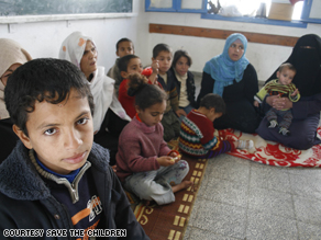 A picture taken Sunday by a Save the Children photographer of a Palestinian family taking refuge in a local school.