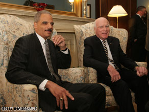 Sen. Leahy, right, is rounding up support for Attorney General-designee Eric Holder, left.