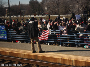 People braved the frigid cold to see Biden off to Washington.