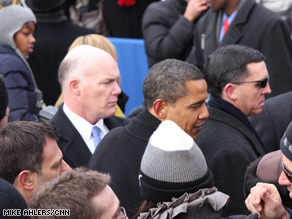Secret Service surrounds Obama as he makes his way through the crowds.