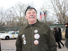 Ohio school teach Norm Huber sported a half dozen buttons as he walked along the inaugural parade route Saturday afternoon.
