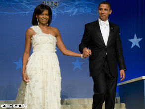 First lady Michelle Obama stepped out Tuesday night in a white detailed gown designed by Jason Wu.