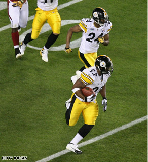 James Harrison of the Pittsburgh Steelers runs back an interception for 100 for a touchdown in the second quarter against the Arizona Cardinals during Super Bowl XLIII.