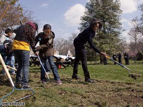 First lady Michelle Obama helped break ground on a new White House 'kitchen garden' Friday.