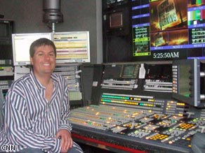 John Rappa sits at his switcher before the show starts.  The switcher is how he controls what goes on the show.